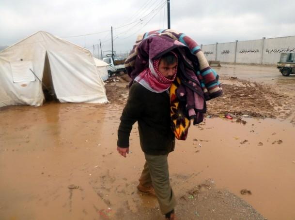 Suriyelilerin yeni yılda yağmur ve çamurla imtihanı 11
