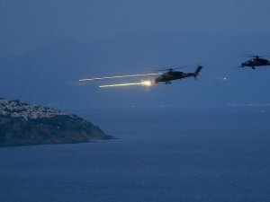 Atak helikopterinden tatbikatta ilk atış