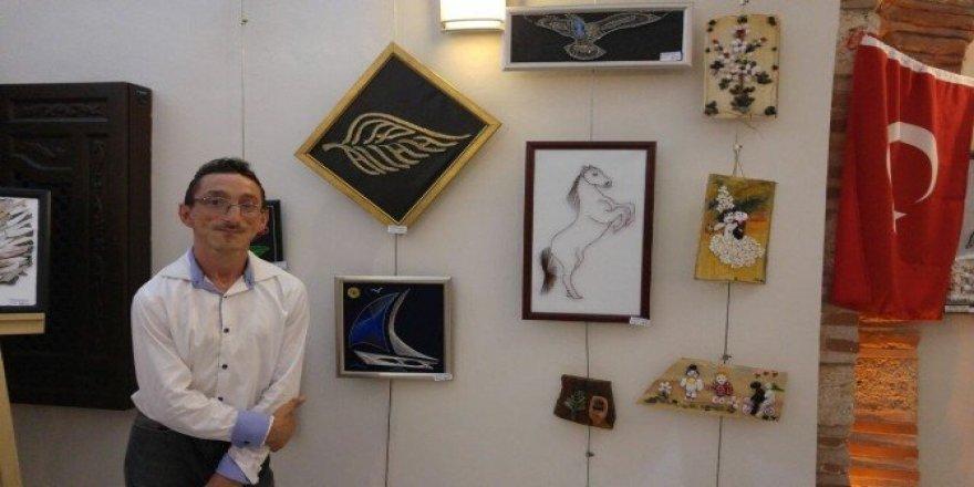 Engelli sanatçıdan muhteşem sergi