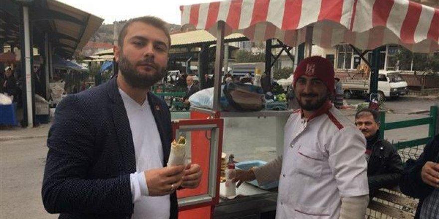 Şehit cenazeleri kalkarken, lahmacun yiyerek yerli malı haftasını kutladı