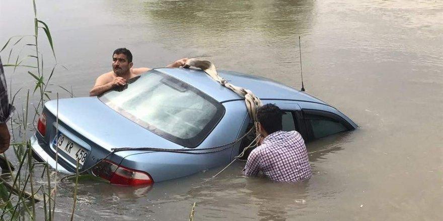 Tansiyonu düşen sürücü nehre uçtu