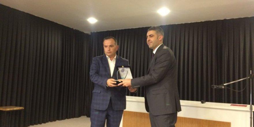 Bozkır'da okul idarecilerine plaket verildi