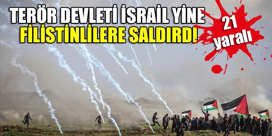 """İsrail askerlerinin abluka altındaki Gazze Şeridi sınırında düzenlenen barışçıl """"Büyük Dönüş Yürüyüşü"""" gösterilerine müdahalesinde 21 Filistinli yaralandı."""