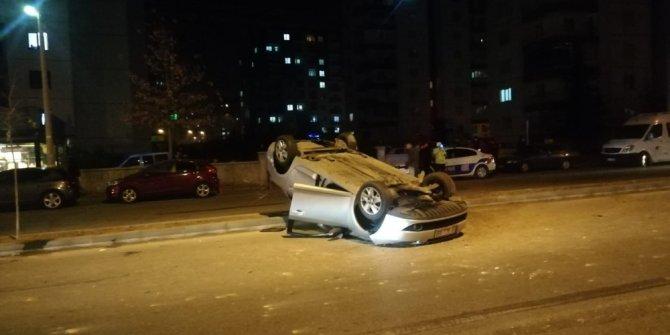Takla atan otomobilden hafif yaralı kurtuldu