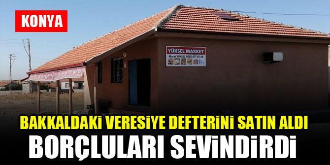 Konya'da bakkaldaki veresiye defterini satın alan hayırsever borçluları sevindirdi