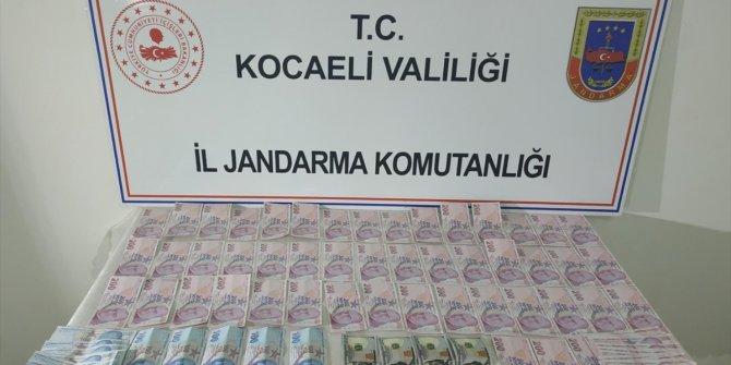 Piyasaya sahte para sürmeye çalışan 9 şüpheli yakalandı