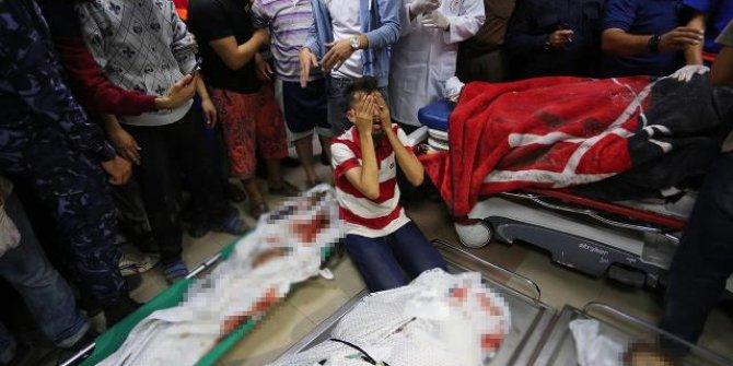 Gazze'de şehitlerin fotoğrafını çekerken iki kardeşini de aralarında gördü