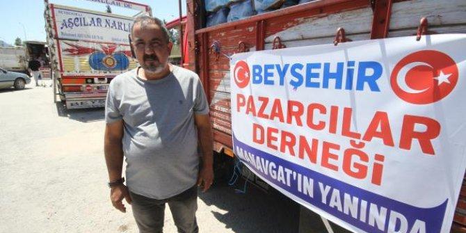 Beyşehirli pazarcılardan yangında zarar gören afetzedelere giyecek ve yiyecek yardımı