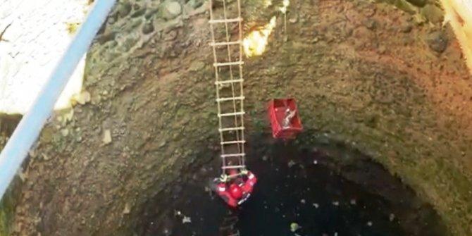 Su kuyusuna düşen kediyi kurtarmak için seferber oldular