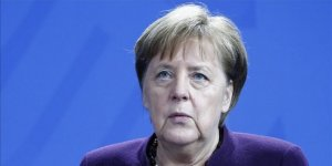 Racism is poison, it exits in our society, admits Merkel