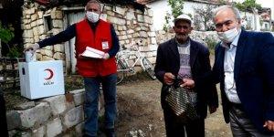 Bahşılı'da ihtiyaç sahiplerine gıda ve dezenfektan yardımı