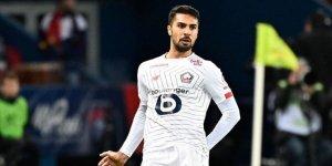 Bakan Kasapoğlu, karantinadaki milli futbolcu Zeki Çelik ile görüştü