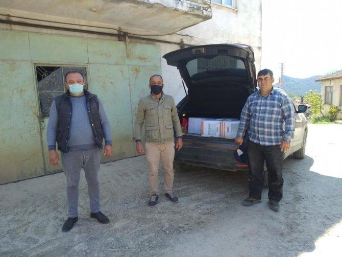 Mahalle ve köylerde 600 koli Ramazan paketi dağıtıldı