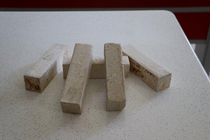 9. sınıf öğrencisi talaştan tuğla üretti