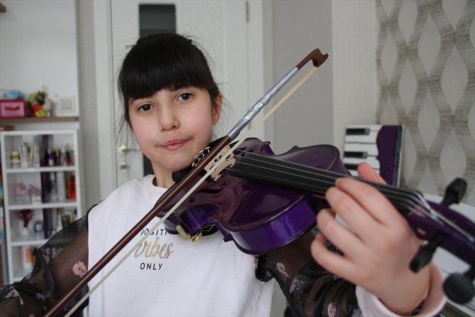 """Di George sendromlu """"mor kemanlı küçük kız"""", müzik tutkusuyla hayata bağlandı"""