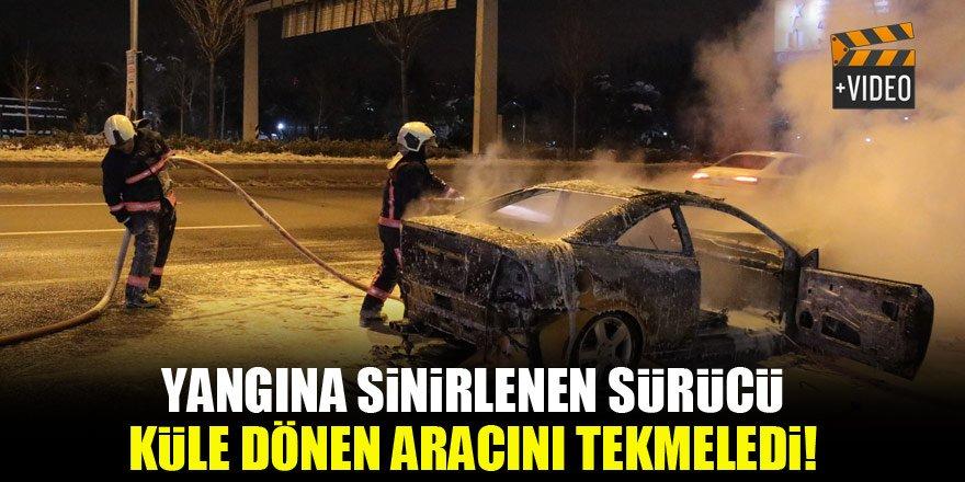 Yangına sinirlenen sürücü küle dönen aracını tekmeledi!