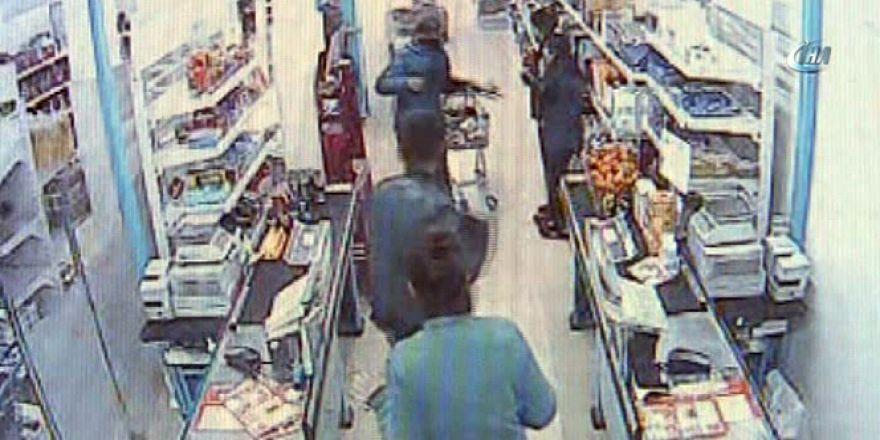 Soygun haberi izleyip, marketten gasp yaptılar